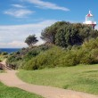 Path to beach with light house, Sydney — Stock Photo