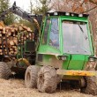 Tree log hydraulic manipulator - tractor - Stock Photo