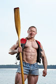 Man with oar — Stock Photo
