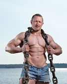 Muscular man with chain on neck — Stock Photo