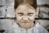 Closeup portrait of angry little girl — Stock Photo