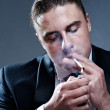 Handsome young smoker — Stock Photo #3795382