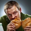 Stock Photo: Hungry mwith mouth full of bread