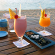 Cocktail by the beach in Mauritius - Stock Photo