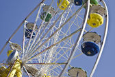 Colorful Ferris wheel in blue sky — Stock Photo