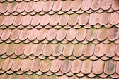 Texture of old red tiled roof — Stock Photo