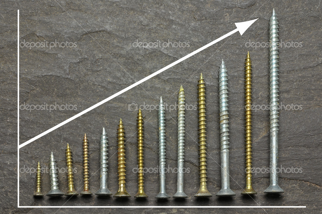 Positive graph using various sized screws as bar charts on slate background  Photo #3422011