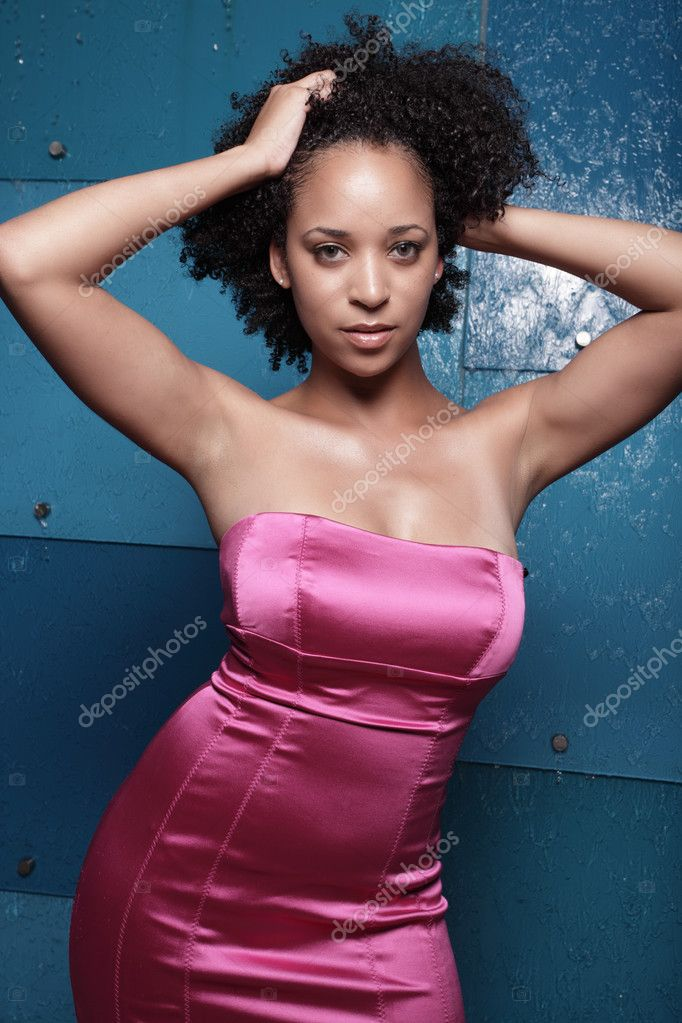 Sexy African American female posing with her hands in her hair — Stock Photo #2914246