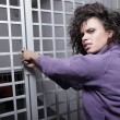 Woman breaking the lock - Stock Photo
