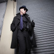 Man in a trench coat and hat — Stock Photo