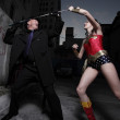 Superhero fighting the villain — Stock Photo