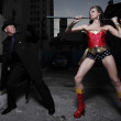Superhero fighting the evil villain - Foto Stock