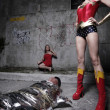 Female superhero and the villain — Stock Photo #3041705