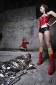 Female superhero and the villain — Stock Photo