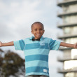 Royalty-Free Stock Photo: Young boy with arms outstretched