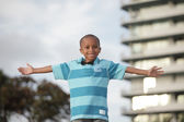 Young boy with arms outstretched — Stock Photo