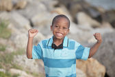 Boy felxing his muscles — Stock Photo