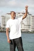 Black man waving — Stock Photo