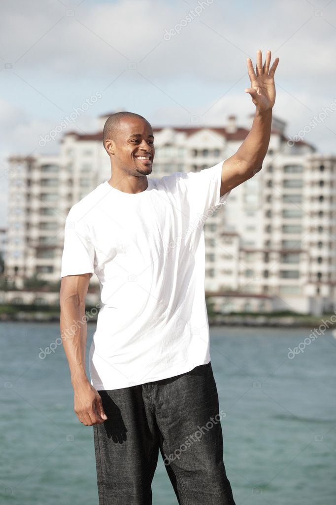 Handsome young black man waving  Stock Photo #3167133
