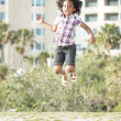 Young child jumping — Stock Photo