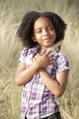Young child in the field — Stock Photo