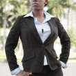 Businesswoman posing akimbo — Stock Photo