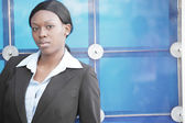 Businesswoman on an abstract background — Stock Photo