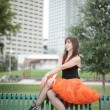 Foto Stock: Womin orange tutu