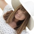 Woman smiling with a hat — Stock Photo #3387081