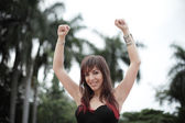 Happy woman with arms raised — Stock Photo