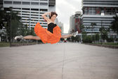 Woman performing a jumping split — Stock Photo