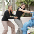 Women turning off the valve — Stock Photo #3522938
