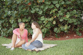 Female couple in the park — Stock Photo
