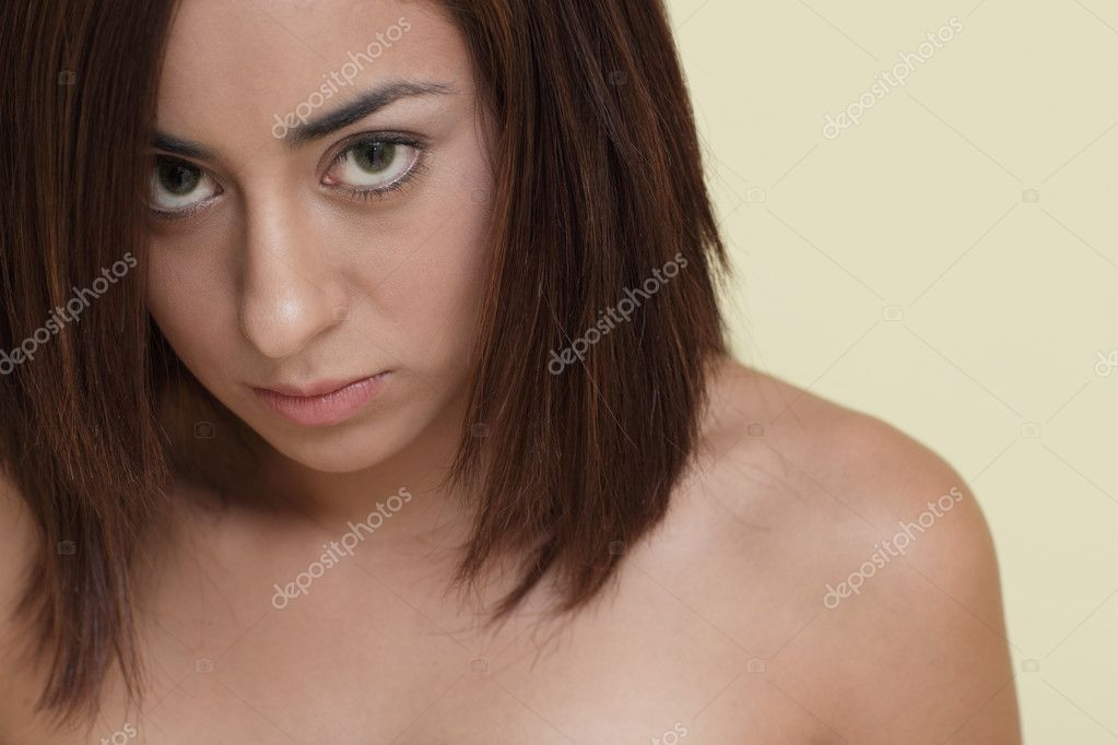 Attractive young woman implied to be nude