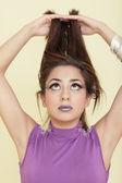 Woman raising her hair — Stock Photo