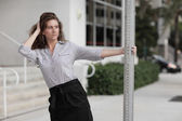 Young businesswoman posing with a pole — Stock Photo
