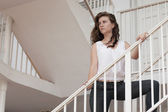 Young woman on the staircase — Stock Photo