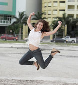 Joyous woman smiling and jumping — Stock Photo