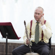 Stock Photo: Clarinet player with an idea