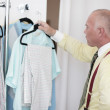 Middle-aged man shopping for clothes — Stock Photo