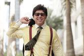 Haandsome businessman walking outside — Stock Photo