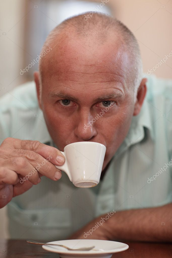 Older white man drinking coffee — Stock Photo #3770048