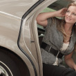 Passenger getting out of the car — Stockfoto