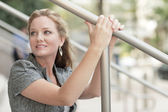 Woman holding on to a handrail — Stock Photo
