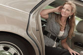 Passenger getting out of the car — Stock Photo