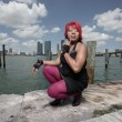 Stock Photo: Woman squatting at the dock