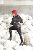 Woman posing on rocks — Stock Photo