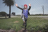 Woman climbing the fence — Stock Photo