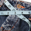 Measuring Blue Jeans — Stock Photo
