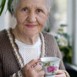 Elderly woman with cup of tea — Stock Photo #3725969